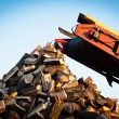 Firewood comes out of a machine — Stock Photo