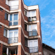 Generic apartment building in Europe against blue sky — Stock Photo #7123429