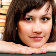 Cheerful young student and her books — Stock Photo #7123439