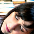Student girl sleeping on her books — Stock fotografie