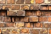 Brick wall texture with a lot of cracks — Foto Stock