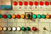 Many big buttons on an industrial board — Stock Photo