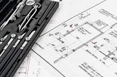 Tools and construction plans as a business background — Stock Photo