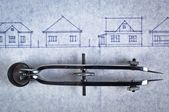 Sketch of houses on a construction plan with a bow — Stock Photo
