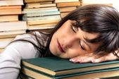 Exhausted student girl and her books — Stock Photo