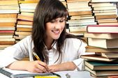 Attractive student girl writing her homework — Stock Photo