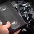 Old VHS tapes ripped apart — Stock Photo #7786243