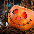 Stock Photo: Halloween pumkin cought in web of chains
