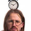 Handsome man with clock on his head — Stock Photo