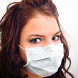 Closeup of a girl in medical mask — Stock Photo #7786520