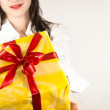 If you were good you will get a present from this beautiful girl — Stock Photo