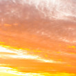 Royalty-Free Stock Photo: Sunset with orange clouds and silhouette of the mountains