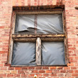 Part of an industrial building with broken window — Stock Photo