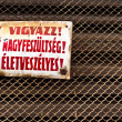 Stock Photo: High voltage sign as industrial background