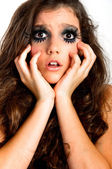 Terrified young girl with extreme makeup — Stock Photo