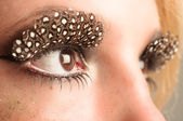 Eye of a girl with extreme makeup — Stock Photo