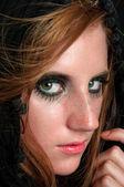 Depressed girl in black cloak — Stock Photo