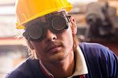 Closeup of an industrial worker in yellow helmet — Stock Photo