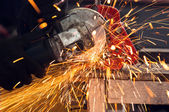 How to use a circular saw to make beautiful sparks — Stock Photo