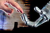 Contact between human and robot — Foto Stock