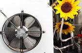 Clean ventilator with beautiful flowers — Stock Photo