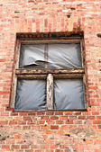 Part of an industrial building with broken window — Stok fotoğraf