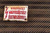 High voltage sign as an industrial background — Foto Stock