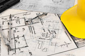Angle shot of some construction plans and some accessories — Stock Photo