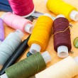 Sewing supplies: thread, scissors, buttons — Stock Photo