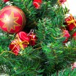 colorful christmas decorations on a tree isolated on a white bac — Stock Photo