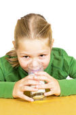 Happy little girl with a glass of milk, isolated over white — Stock Photo