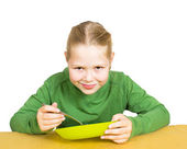 Girl eats isolated on white — Stock Photo