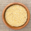 Rice in wooden plate — Foto Stock