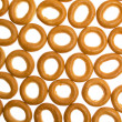 Many bagels on white background — Foto Stock