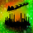 Santa Clause flying above the city — Stockfoto