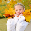 Girl with yellow leaves — Stock Photo #7144904