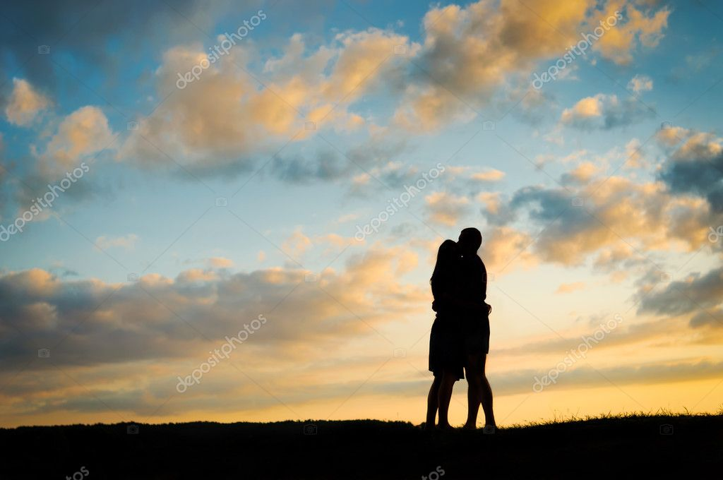 Silhouette young couple  at sunset  — Stock Photo #7224332