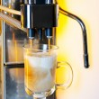 Making cappuccino in coffee machine - Stock Photo