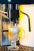 Making cappuccino in coffee machine — Stock Photo