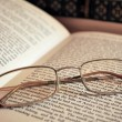 Royalty-Free Stock Photo: Eyeglasses lying on open book concept image