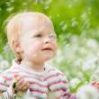A portrait of a cute little baby in the grass — ストック写真