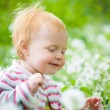 A portrait of a cute little baby in the grass — Stock Photo #6883248