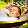 Young man sleeping in a hammock - Stock Photo
