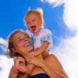 Baby with her mother on the beach — Stock Photo