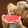 Infant baby with a melon — Stock Photo #6883374