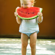 Infant baby with a melon — Foto de Stock