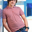 Portait of a young man standing with his hands in pocket — Stock Photo #6883391