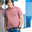 Portait of a young man standing with his hands in pocket — Stock Photo #6883392