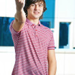 A young man is showing fuck sign with the middle finger — Stock Photo #6883396