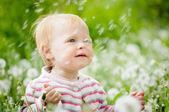 A portrait of a cute little baby in the grass — Stock Photo